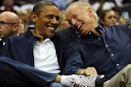 US President Barack Obama (L) share a laugh with Vice President Joe Biden as the US national basketball team plays Brazil on July 16. Obama got a bird&#39;s-eye view of the current USA national team, sitting courtside at the Verizon Center arena with his family and Vice President Joe Biden