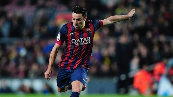 Xavi Hernandez scores during the Spanish league football match FC Barcelona vs UD Almeria at the Camp Nou stadium in Barcelona on March 2, 2014