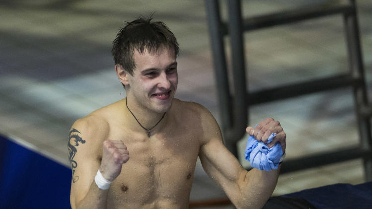 Russia's Victor Minibaev reacts after winning the men's 10m platform diving final at the LEN Swimming European Championships in Berlin, Germany, Saturday, Aug. 23, 2014. (AP Photo/Gero Breloer)