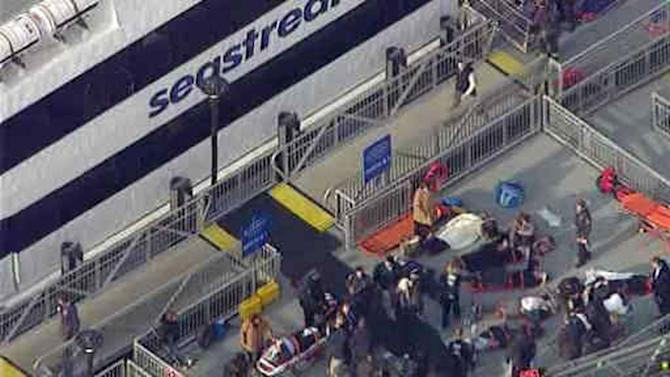 ADDS NUMBER OF PEOPLE INJURED- This aerial photo provided by WABC News Channel 7 shows emergency personnel at the scene of a ferry crash in Lower Manhattan, Wednesday, Jan. 9, 2013, in New York. The Fire Department says at least 50 people were injured when a ferry from New Jersey struck a dock during rush hour. (AP Photo/WABC News Channel 7)