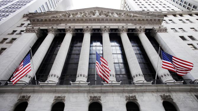 FILE - In this Feb. 10, 2011 file photo, American flags fly in front of the New York Stock Exchange, in New York. Asian stock markets fell for a second day Thursday June 12, 2014 and European shares drifted as a dimmer outlook for global growth this year gave investors a reason to lock in recent gains. (AP Photo/Mark Lennihan, File)