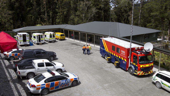 Rescue team wait near the Pike River Coal mine offices,  as 29 workers are still trapped inside the coal mine after an underground explosion, in Greymouth, New Zealand, Sunday, Nov. 21, 2010.(AP Photo/Pool)