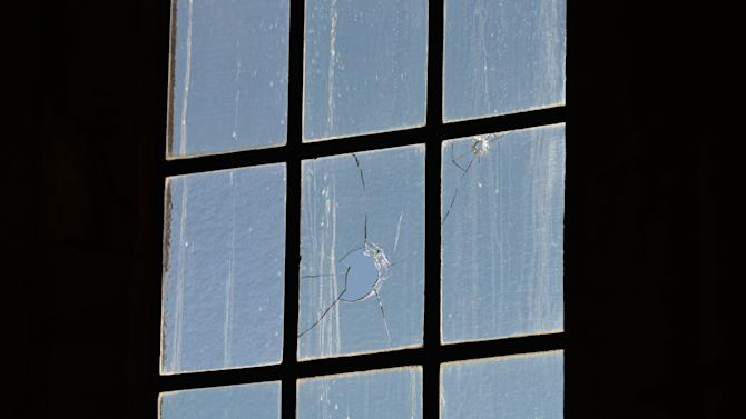 Bullet holes are shown in a window of the rotunda of the House of Commons in Ottawa on Thursday Oct. 23, 2014. Michael Zehaf Bibeau fatally shot reservist Cpl. Nathan Cirillo on Wednesday, at the National War Memorial before setting his sights on Parliament Hill. Bibeau was killed just feet from where hundreds of MPs were meeting for their weekly caucus meetings. (AP Photo/The Canadian Press, Sean Kilpatrick)