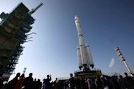 File photo shows China&#39;s Long March 2-F rocket, carrying the Tiangong-1 space module, at the Jiuquan Satellite Launch Centre in China&#39;s Gansu in September 2011. China will launch a manned spacecraft this month, Xinhua said Saturday