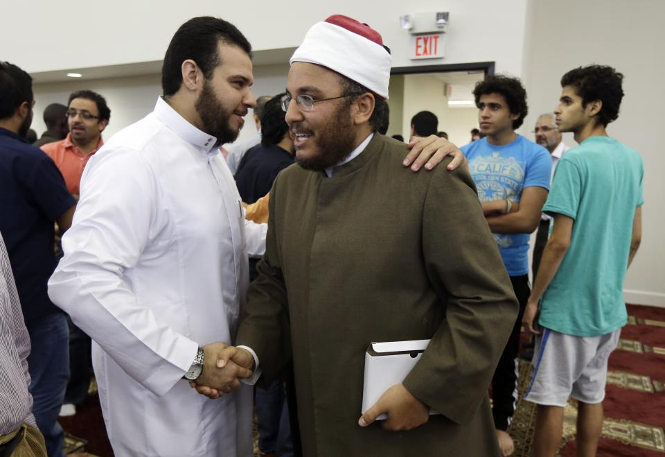 Dr. Ossama Mohamed Bahloul, center, greets worshipers after leading midday prayers at the Islamic Center of Murfreesboro on Friday, Aug. 10, 2012, in Murfreesboro, Tenn. Opponents of  the mosque waged a two-year court battle trying to keep it from opening. (AP Photo/Mark Humphrey)