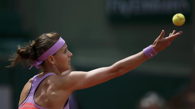 Lucie Safarova of the Czech Republic serves to Garbine Muguruza of Spain during their women's quarter-final match during the French Open tennis tournament at the Roland Garros stadium in Paris