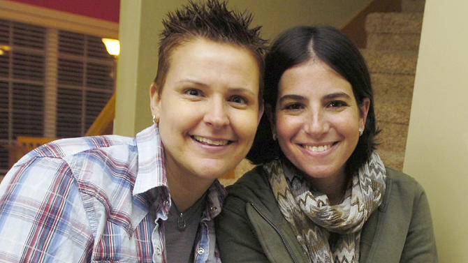 In this 2011 photo is Amy Sandler, right, and her wife Niki Quasney in Munster, Ind. Indiana will be required to recognize the couple's out-of-state marriage for at least a few days more as a federal judge considers whether to extend an April order that expires May 8, 2014 requiring the state to acknowledge the union. Quasney is terminally ill with advanced ovarian cancer, and the couple fear Sandler's ability to collect Social Security and other death benefits would be harmed if their marriage isn't recognized. (AP Photo/Sun-Times Media, Jeffrey D. Nicholls)