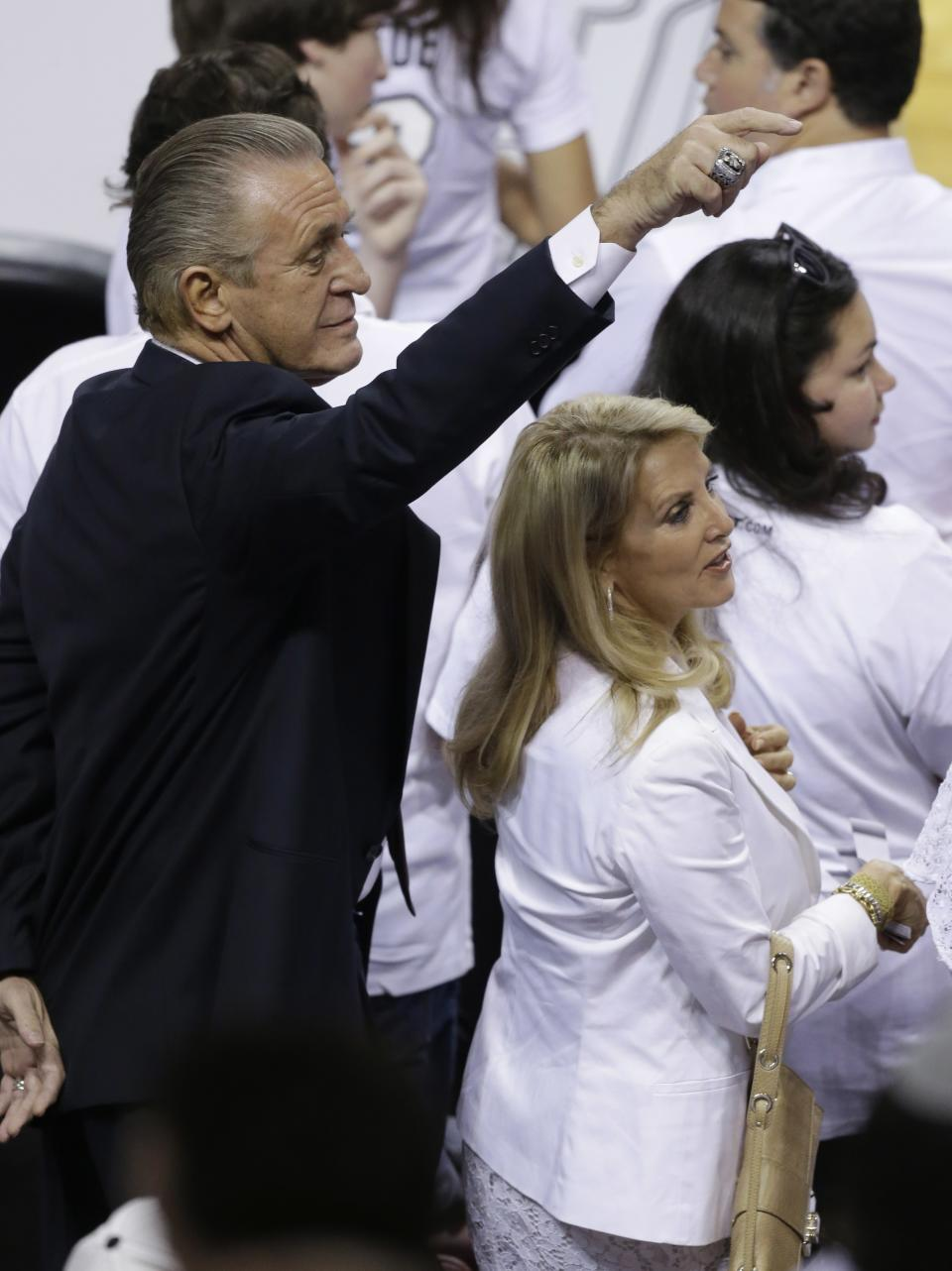 Miami Heat president Pat Riley and his wife Chris watch action before the first half in Game 7 of the NBA basketball championships against the San Antonio Spurs, Thursday, June 20, 2013, in Miami. (AP Photo/Wilfredo Lee)