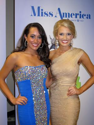 Miss New Hampshire Samantha Russo, left, and Miss Mississippi Chelsea Rick pose for photographers after winning the first night of preliminary competition in the Miss America pageant in Atlantic City, N.J. on Tuesday, Sept. 10, 2013. Russo won the talent competition while Rick won the swimsuit competition. (AP Photo/Wayne Parry)