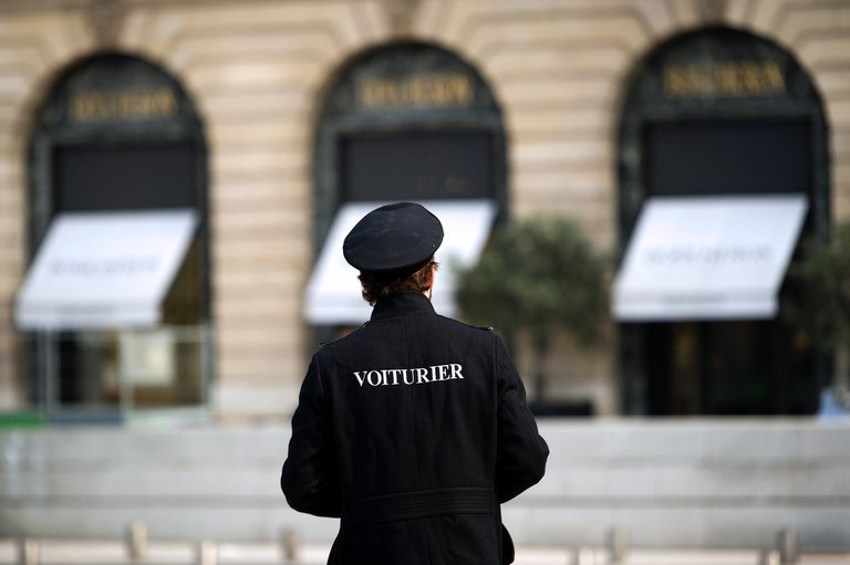 File picture shows a valet on the Place Vendome in Paris on April 26, 2013