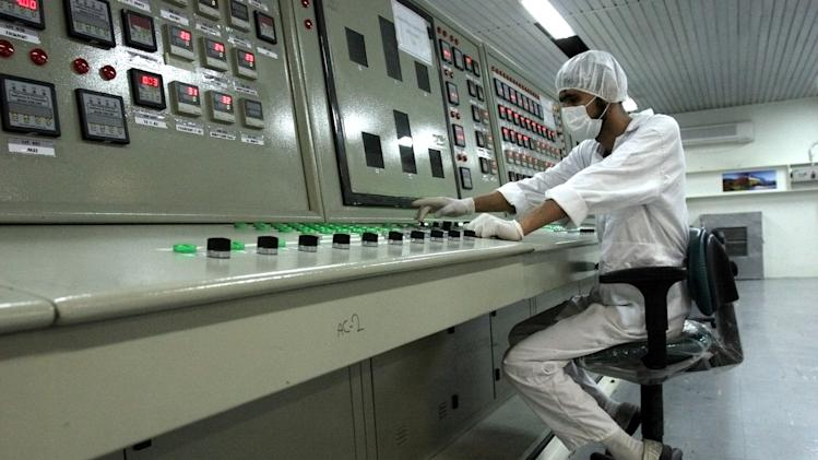 """FILE - In this Saturday, Feb. 3, 2007 file photo, an Iranian technician works at the Uranium Conversion Facility just outside the city of Isfahan 255 miles (410 kilometers) south of the capital Tehran, Iran. Iran is considering a more confrontational strategy at possible renewed nuclear talks with world powers, threatening to boost levels of uranium enrichment unless the West makes clear concessions to ease sanctions. Such a gambit outlined by senior Iranian officials in interviews could push Iran's atomic program far closer to Israel's """"red line."""" (AP Photo/Vahid Salemi, File)"""