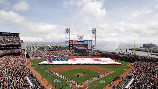 A large U.S. flag is extended on the field before a baseball game between the San Francisco Giants and the St. Louis Cardinals on Friday, April 5, 2013, in San Francisco. (AP Photo/Tony Avelar)