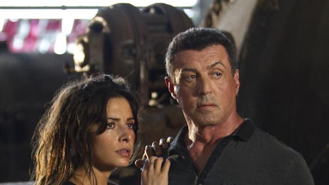 "This film image released by Warner Bros. Pictures shows Sarah Shahi, left, and Sylvester Stallone in a scene from ""Bullet to the Head."" (AP Photo/Warner Bros. Pictures, Frank Masi)"