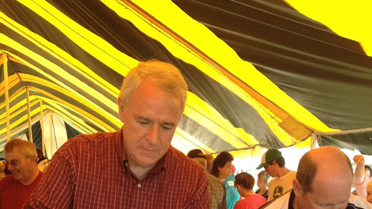 Milwaukee Mayor Tom Barrett, left, the Democratic challenger to Republican Gov. Scott Walker in Wisconsin's recall election Tuesday, serves eggs at a dairy breakfast in the Town of Rockland, Wis., on Sunday, June 3, 2012. Next to him is Republican U.S. Rep. Reid Ribble. (AP Photo/Roger Schneider)