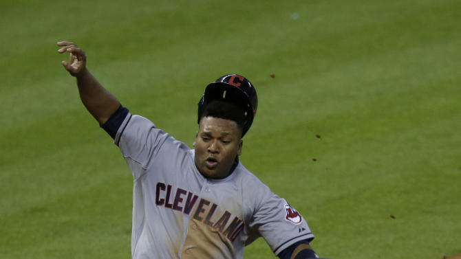 Cleveland Indians' Jose Ramirez slides into home plate to score against the Houston Astros as catcher Jason Castro captures the ball in the 13th inning of a baseball game Thursday, Sept. 18, 2014, in Houston. Ramirez scored from third base on a Mike Aviles sacrifice fly. (AP Photo/Pat Sullivan)
