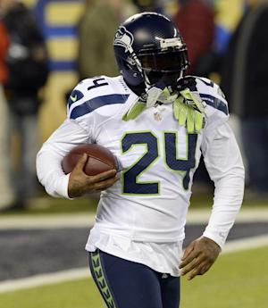 Lynch ends holdout, arrives at Seahawks camp