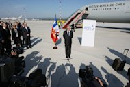 Chilean President Sebastian Pinera (C) arrives to attend the Asia-Pacific Economic Cooperation (APEC) summit in Vladivostok. Asia-Pacific leaders meet on Saturday for annual talks, hoping to present a united front amid a gloomy world economy but with team spirit frayed by increasingly hostile territorial rows