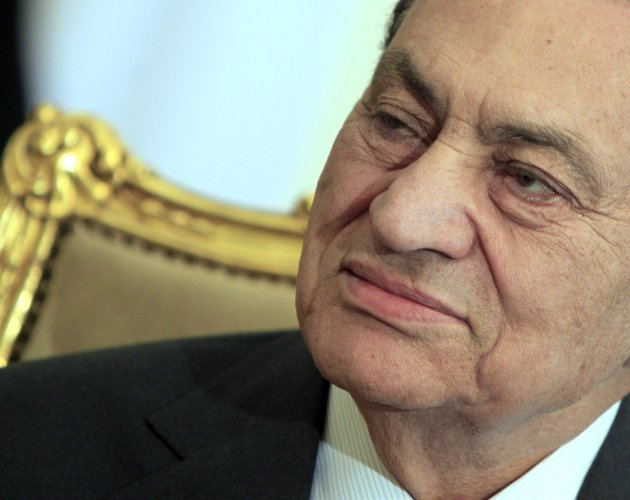 FILE - In this Tuesday, Feb. 8, 2011 file photo, the Egyptian President Hosni Mubarak sits during his meeting with Emirates foreign minister, not pictured, at the Presidential palace in Cairo, Egypt.
