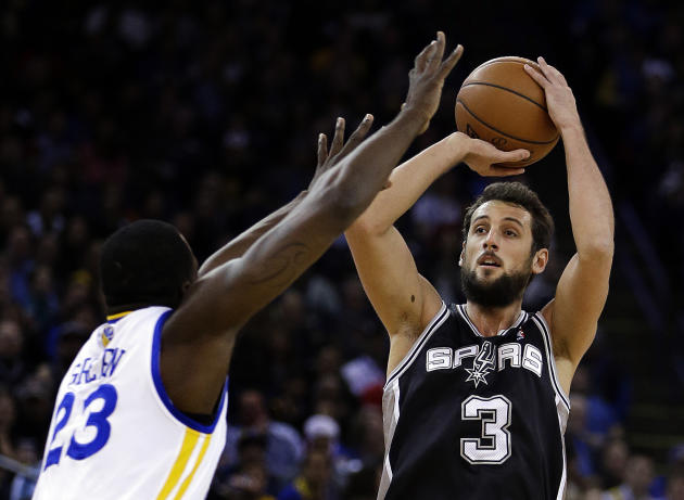 San Antonio Spurs' Marco Belinelli, right, shoots over Golden State Warriors' Draymond Green during the first half of an NBA basketball game, Thursday, Dec. 19, 2013, in Oakland, Calif