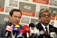 Coahuila state prosecutor Homero Ramos (L), accompanied by a member of his staff Gerardo Villareal, speaks during a press conference regarding the death of the founder of the Zetas drug cartel Heriberto Lazcano. A major coup for Mexican authorities turned to embarrassment as it emerged Lazcano's body had been stolen from a funeral parlor