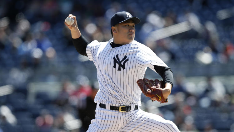 New York Yankees starting pitcher Masahiro Tanaka delivers in the first inning of Game 1 of an interleague baseball doubleheader against the Chicago Cubs at Yankee Stadium in New York, Wednesday, April 16, 2014. (AP Photo/Kathy Willens)