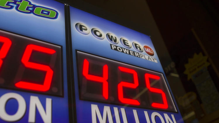Signage showing the current jackpot of the Powerball outside of a convenience store in Chicago, Wednesday, Aug. 7, 2013. Ticketholders are hoping to win Wednesday's Powerball drawing, estimated at $425 million so far. (AP Photo/Scott Eisen)