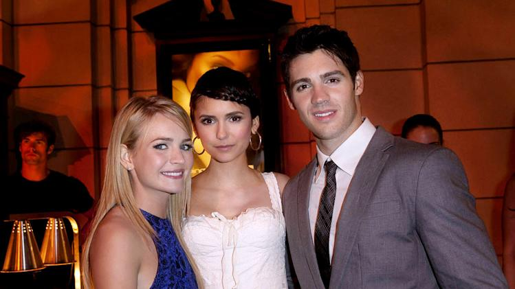 "Britt Robertson (""The Secret Circle""), Nina Dobrev (""The Vampire Diaries""), and Steven R. McQueen (""The Vampire Diaries"") attend The CW Fall Premiere party presented by Bing at Warner Bros. Studios on September 10, 2011 in Burbank, California."