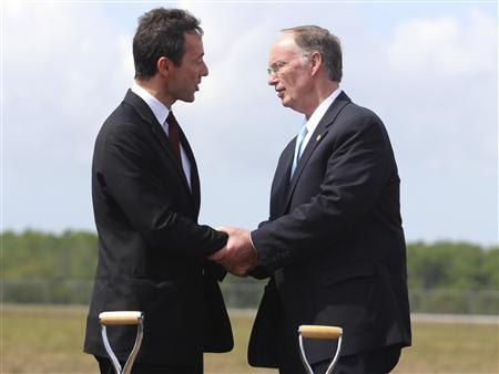 Fabrice Bregier, Airbus President and CEO shakes hands with Alabama Governor Robert Bentley (R), after breaking ground on its first U.S. assembly plant in Mobile, Alabama April 8, 2013. REUTERS/Lyle Ratliff