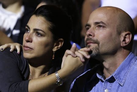 "Gerardo Hernandez , one of so-called ""Cuban Five"", and his wife Adriana Perez (L) attend a concert of the Cuban musician Silvio Rodriguez in Havana"