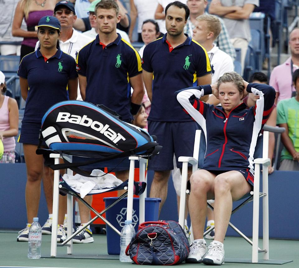Kim Clijsters of Belgium sits on the side of the court after losing to Laura Robson of Great Britain in the second round of play at the 2012 US Open tennis tournament,  Wednesday, Aug. 29, 2012, in New York. (AP Photo/Mel C. Evans)