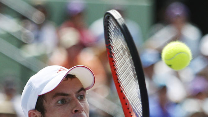 Andy Murray, of Britain, returns a shot from Novak Djokovic, of Serbia, during the men's singles final at the Sony Ericsson Open tennis tournament, Sunday, April 1, 2012, in Key Biscayne, Fla. Djokovic defeated Murray, 6-1, 7-6 (4). (AP Photo/Wilfredo Lee)