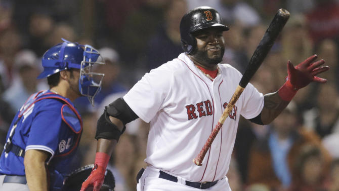 Boston Red Sox designated hitter David Ortiz reacts after striking out to end the seventh inning of a baseball game against the Toronto Blue Jays at Fenway Park, Thursday, June 27, 2013, in Boston. At left is Blue Jays catcher J.P. Arencibia. (AP Photo/Charles Krupa)