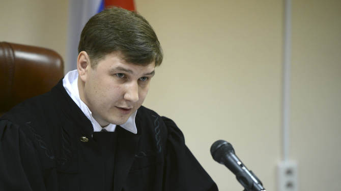 Judge Sergei Blinov speaks in a courtroom during the trial of Russian opposition leader Alexei Navalny in Kirov, Russia, Wednesday, April 17, 2013. The trial of the Russian opposition leader accused of embezzling half a million dollars' worth of timber from a state-run company has started in the northwestern city. (AP Photo/Mitya Aleshkovskiy)