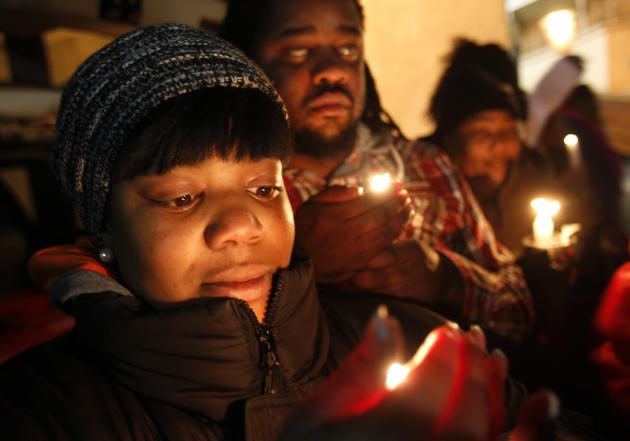 Tamika Solomon, of Newark, N.J., takes part in a candlelight vigil as they wait for Whitney Houston's body to arrive at the Whigham Funeral Home, in Newark, N.J., Monday, Feb. 13, 2012. The 48-year-ol