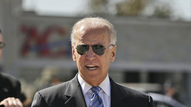 Vice President Joe Biden walks toward his vehicle on the tarmac upon his arrival on Air Force Two at Lexington Blue Grass Airport, Thursday, Oct. 11, 2012, in Lexington, Ky., for the vice presidential debate.  (AP Photo/Pablo Martinez Monsivais)