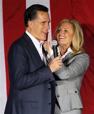 Ann Romney wipes lipstick off her husband's face after kissing him at a campaign rally in Zanesville, Ohio, Monday, March 5, 2012. (AP Photo/Gerald Herbert)