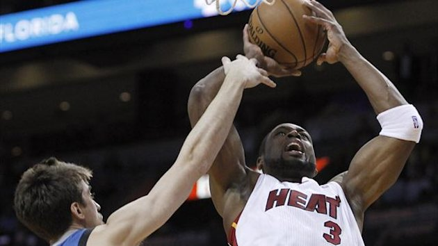 Miami Heat's Dwyane Wade shoots against Minnesota Timberwolves' Alexey Shved (Reuters)
