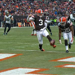Cleveland Browns quarterback Brandon Weeden kicks ball out of the end zone