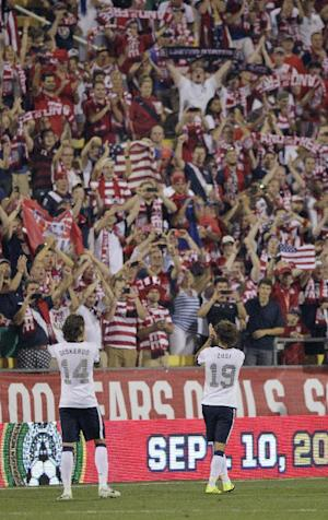 United States' Mix Diskerud, left, and Graham Zusi celebrate the team's 2-0 win over Mexico in a World Cup qualifying soccer match Tuesday, Sept. 10, 2013, in Columbus, Ohio. (AP Photo/Jay LaPrete)