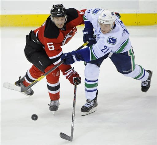 Canucks beat Devils 2-1; Schneider has 30 saves