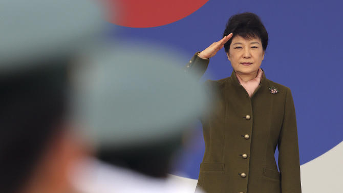 "FILE - In this Friday, March 8, 2013 file photo, South Korean President Park Geun-hye salutes during a joint commission ceremony of 5,780 new officers of Army, Navy, Air Force and Marines at the Gyeryong military headquarters in Gyeryong, south of Seoul, South Korea. The body that controls North Korea's military is dismissing the South Korea's new president with a sexist comment about the ""venomous swish"" of her skirt. An unidentified spokesman for the National Defense Commission's armed forces ministry also repeated North Korean vows from recent days of a ""merciless retaliation"" over ongoing U.S.-South Korean military drills. The statement Wednesday, March 13, reiterates another North Korean promise to no longer abide by the armistice that ended the Korean War. (AP Photo/Yonhap, Ahn Jung-won, File) KOREA OUT"