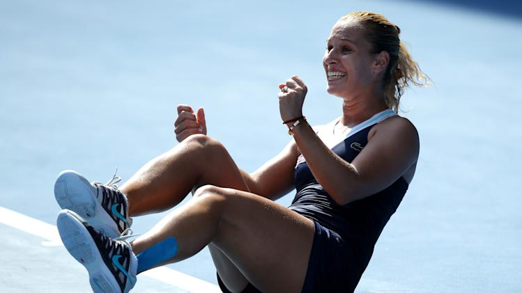 Dominika Cibulkova of Slovakia celebrates after defeating Agnieszka Radwanska of Poland during their semifinal at the Australian Open tennis championship in Melbourne, Australia, Thursday, Jan. 23, 2014.(AP Photo/Aaron Favila)