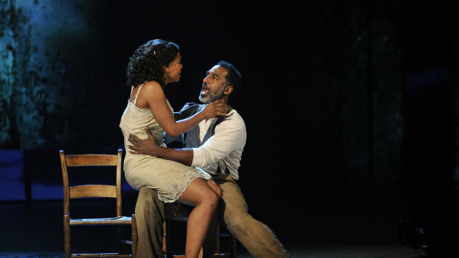 """Audra McDonald, left, and Norm Lewis perform in a scene from """"The Gershwins' Porgy and Bess"""" at the 66th Annual Tony Awards on Sunday June 10, 2012, in New York. The production wona Tony Award for best revival of a musical.  (Photo by Charles Sykes /Invision/AP)"""