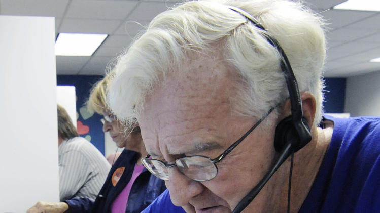 In this Oct. 23, 2012, photo, Joe Norquist, a retired doctor, calls fellow senior citizens from a Shoreview, Minn, phone bank to urge them to vote against a proposed constitutional ban on gay marriage on Minnesota's statewide ballot next month. The phone bank was sponsored by Minnesotans United for All Families, the campaign trying to defeat the amendment. (AP Photo/Jim Mone)