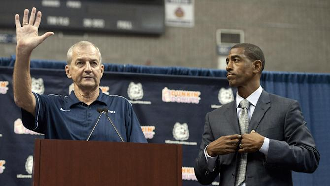 Connecticut head coach Jim Calhoun, left, gestures as Kevin Ollie, right, looks on during a news conference announcing Calhoun's retirement, Thursday, Sept. 13, 2012,  in Storrs, Conn.  Ollie, an assistant coach under Calhoun, will succed him.  (AP Photo/Jessica Hill)