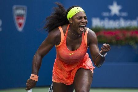 Williams of the U.S. celebrates after defeating Bertens of the Netherlands during their second round match at the U.S. Open Championship tennis tournament in New York