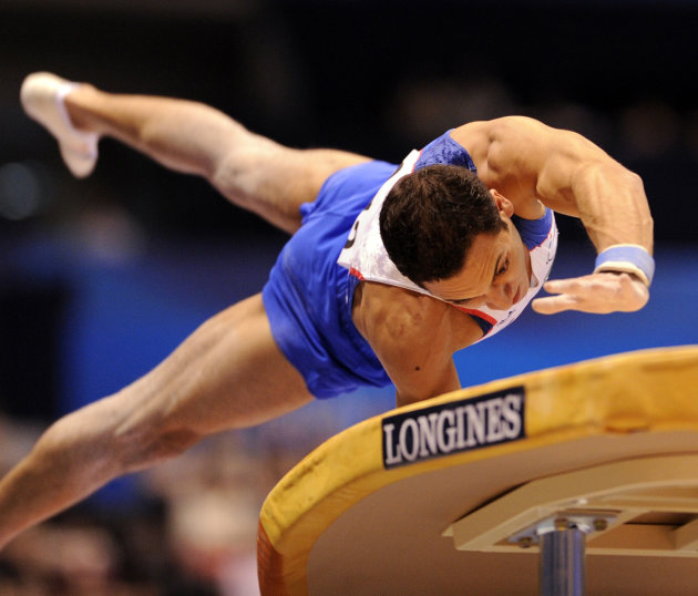 Thomas Bouhail of France performs on the vault during men's vault final of the World Gymnastics Championships in Tokyo on October 16, 2011.   AFP PHOTO / KAZUHIRO NOGI (Photo credit should read KAZUHI