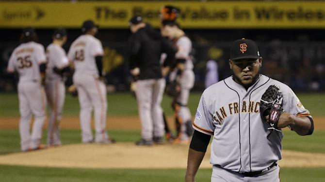 San Francisco Giants pitcher Jean Machi is relieved by Javier Lopez during the sixth inning after allowing a run by the Kansas City Royals in Game 2 of baseball's World Series Wednesday, Oct. 22, 2014, in Kansas City, Mo. (AP Photo/Matt Slocum)