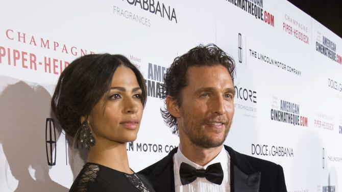 Actor and honoree McConaughey and his wife Alves pose at the 28th American Cinematheque Award ceremony in Beverly Hills