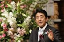 "Japan's Prime Minister Shinzo Abe delivers a speech at a dinner during the 19th International Conference on ""The Future of Asia"" in Tokyo"